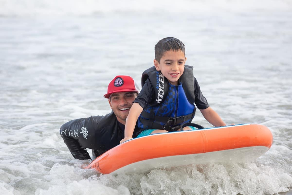 Surfing on the TANDM Surf boards builds confidence